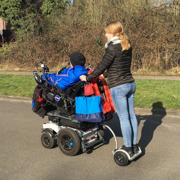 Running board trailer for electric vehicle or electric wheelchair